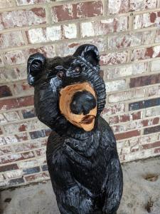 Cartoon black bear chainsaw carving