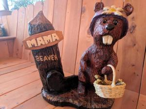 Chainsaw carved beaver with tree