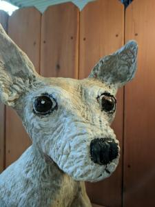 Chihuahua dog face chainsaw wood carving
