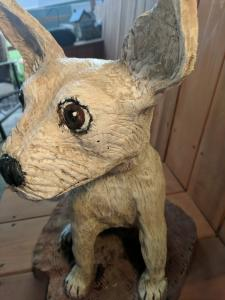 Chihuahua dog sitting chainsaw wood carving