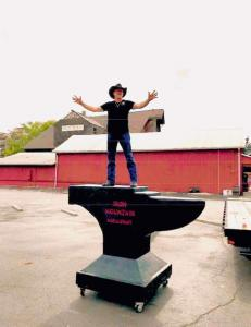 Robby Bowman standing on Wood Carved Creations Anvil