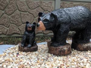 Walking black bear with cub 4